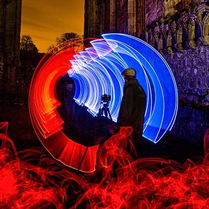 Tripping the Light Fantastic - A photorapher captures the Historic Bolton Abbey Priory surrounded by a kaleidoscope of colours .
